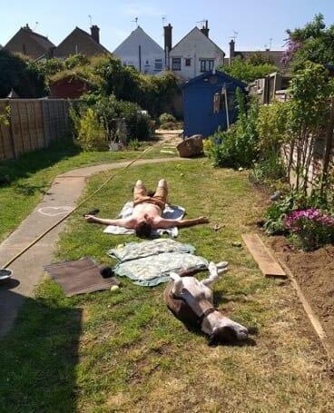 Dan and Bella suntanning
