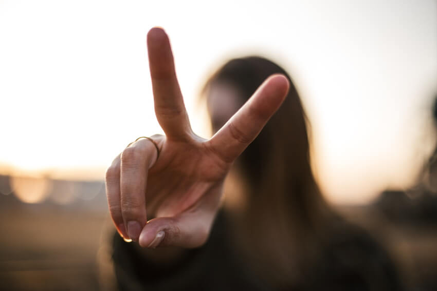 girl showing a peace sign
