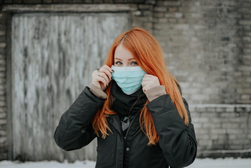 Girl wearing a blue mask